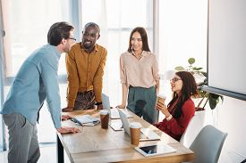 interracial-group-business-colleagues-discussing-work_cg2p47794058c_th